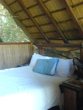 Praia Do Sol: The bed was made neater than this, but I had already sat on it.