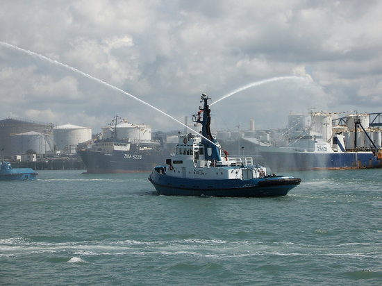 A Auckland tug boat heralding a fourthcoming harbour exhibition in Auckland harbour