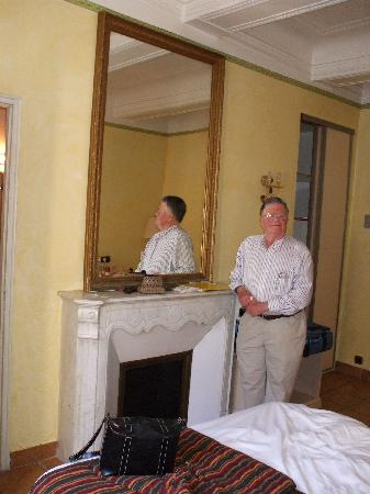Hotel Artea: Husband standing by (non-working) fireplace in our room
