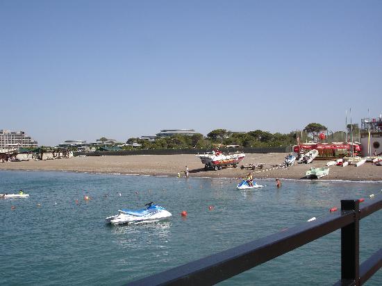 Cornelia Diamond Golf Resort & Spa: water sports area and a view over Calista Luxury Resort-left