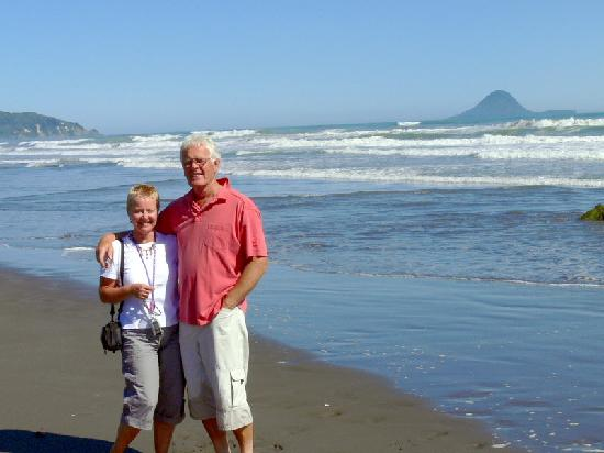 OceanSpray Homestay: Us on Ohope Beach with Whale island in the distance