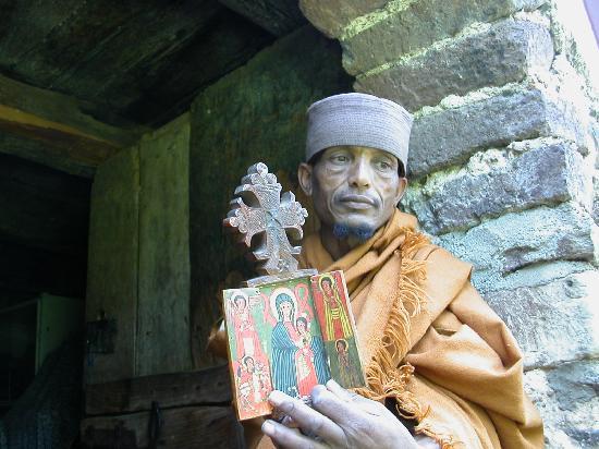 Lake Tana: Priest displaying treasures