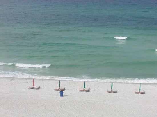 Sunbird Suites : Pic of the beach chairs and vie from our private balcony