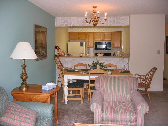 The Historic Powhatan Resort: View of kitchen and dining area from living room near exit to balcony/deck