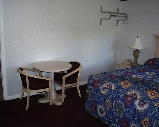 The Rocky River Inn: A table and two chairs are on the side