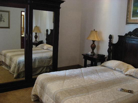 La Perla Hotel Room #A5 with TV, refrig, safe, robe in armoire