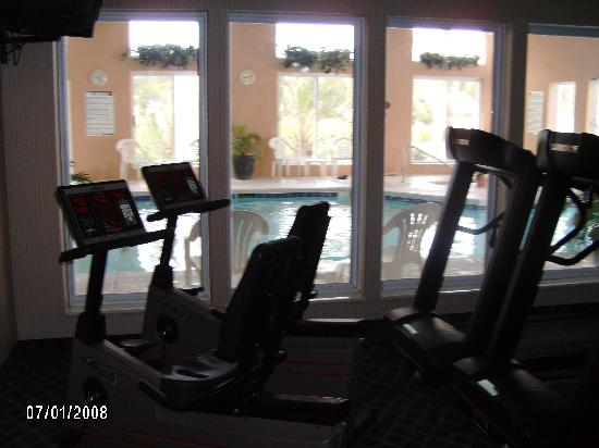 Sleep Inn at Harbour View: the workout room overlooking the pool