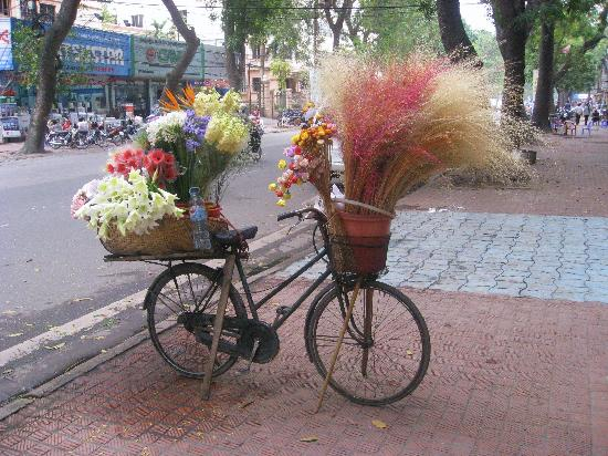 Somerset Grand Hanoi: Flower lady's stall outside hotel