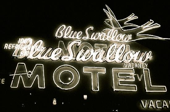 Blue Swallow Motel: Night time double exposure of sign