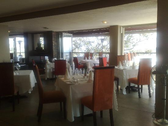 Ready for service! Main Orange Restaurant dining room with fireplace in corner