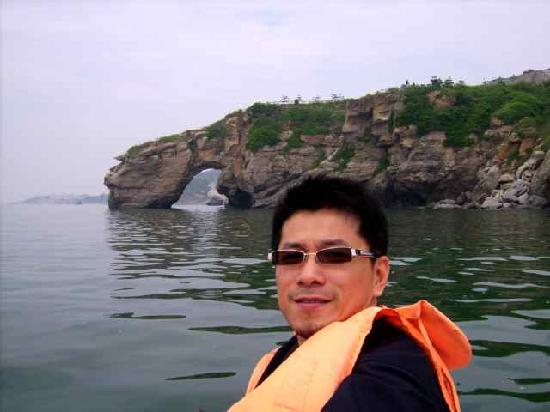 Dalian, China: Behind is the rock they call Dinasour for a drink