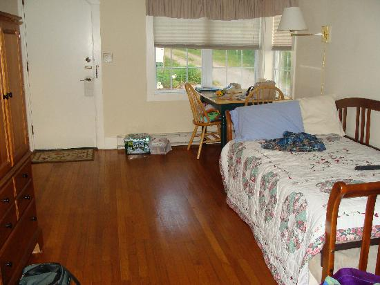"The Country Inn at Camden / Rockport : ""Main"" part of cabin showing trundle bed and table & chairs from deck door."
