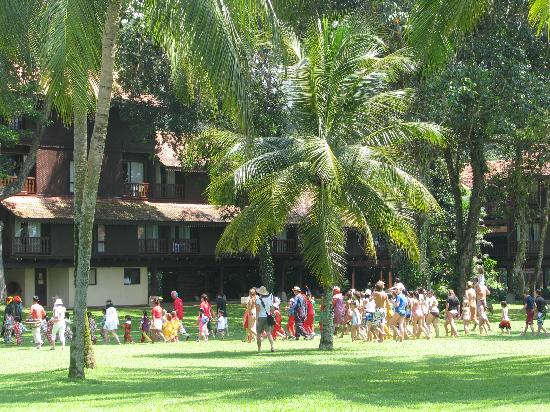 Club Med Cherating Beach: childrens parade through the grounds