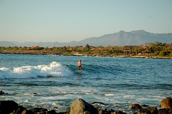 Surfer in Troncones Bay