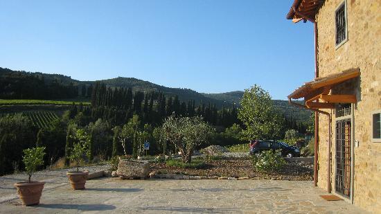 Podere Castelfidardo: View to the carpark and the hills