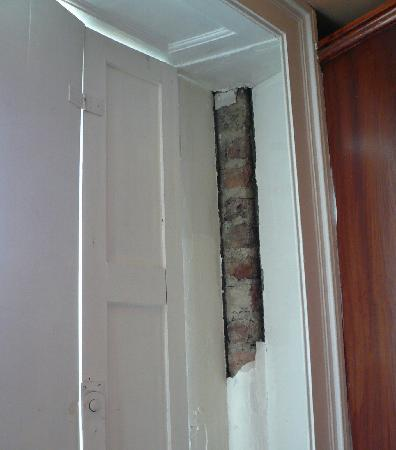 Inn on the Liffey: Missing part of wall in room