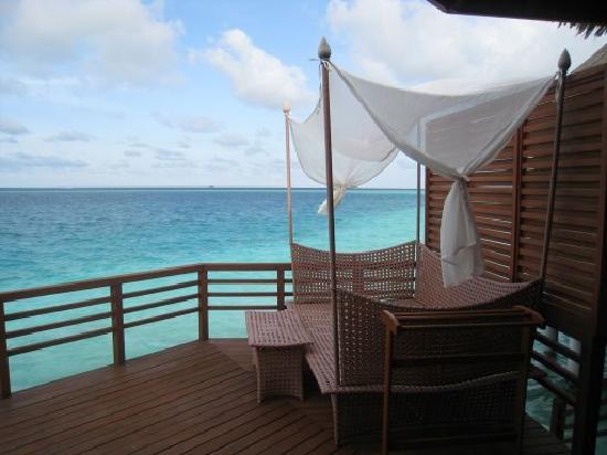 Baros Maldives: Water villa deck bed