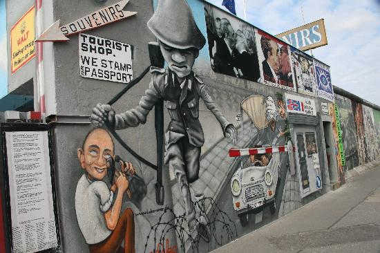 Cartoon of checkpoint charlie picture of east side gallery berlin