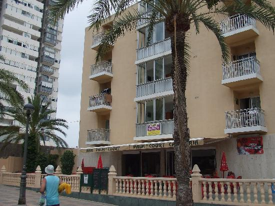 Palm Court Apartments : We had the bottom left balcony on this picture which was perfect for watching the world go by.