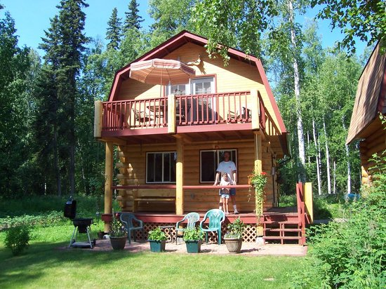 Riverbend Log Cabins & Cottage Rentals: my husband and our daughter on Chinook Cabin deck...