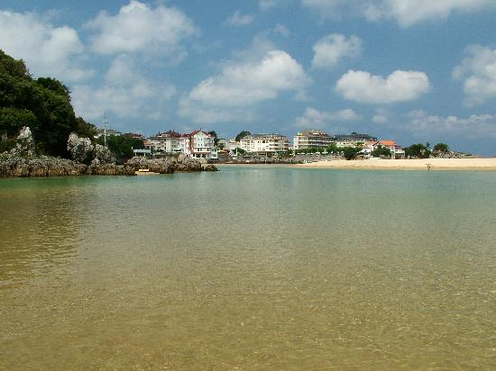 Camping Playa Joyel : From the small clean river beside the camp site beach looking towards the small town of Isla
