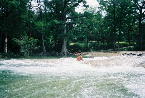 7A Ranch Resort: Sliding down the slippery rocks with a push of the current