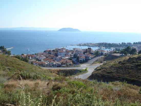 Neos Marmaras with its small port and Kelyfos island in the background