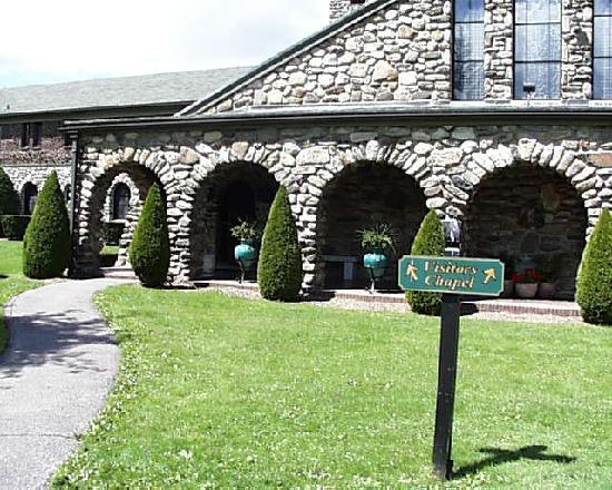 Saint Joseph's Abbey: A Series of Arches front the church in the area of the visitors' chapels, actually the back.