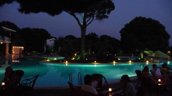 Jacaranda Club & Resort: other  pool  area  at  night  time.