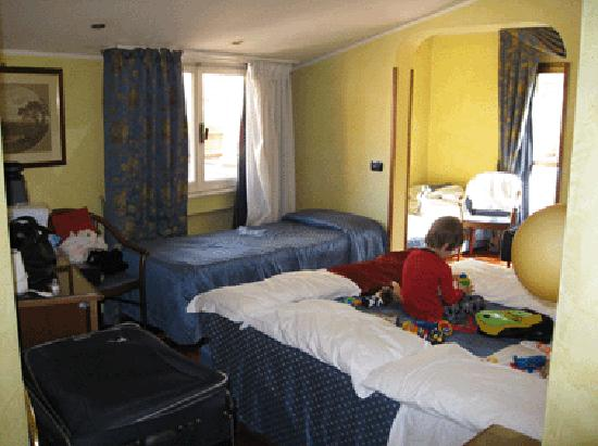 """Hotel Centro Roma: This is a """"quad"""" room - a bit squishy with all the extra luggage (travelling with baby and child"""