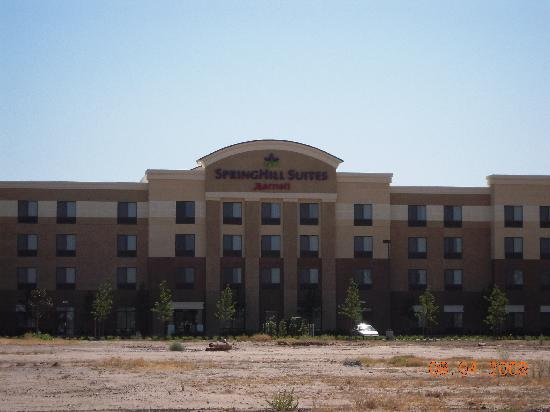 SpringHill Suites Fresno: Hotel with large empty field next to it.