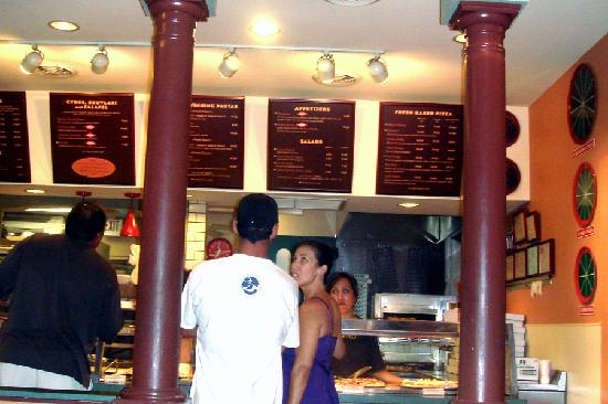Pizza Paradiso Mediterranean Grill : Order counter with pizza on display