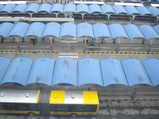 Beijing Railway Hotel: Looking straight down from my window. The buses run from early in the morning to late in the nig
