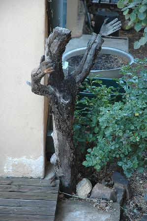 The Guadalupe Inn: Guadalupe Inn-Tree branch sculpture by Henrietta Quintana