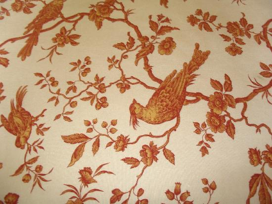 Hotel Le Clos St-Louis: Close up of bedspread fabrice.  Matches drapes.