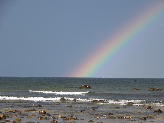 Rainbow on the beach at the OC Studio Suites
