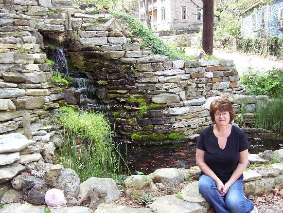 The Benton Place Inn: Judy at the Benton Place water fall and pond....
