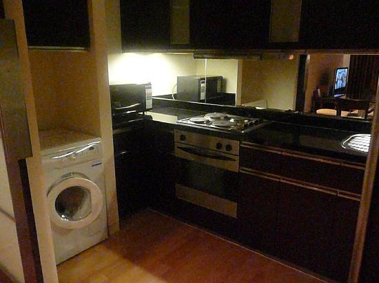 Emporium Suites by Chatrium: kitchen with washer-dryer