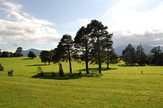 Coolclogher House: The gardens and fields with view of the kerry mountains.