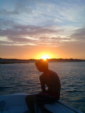 Aqua Marine Boat Charters: Skipper Neil at sunset