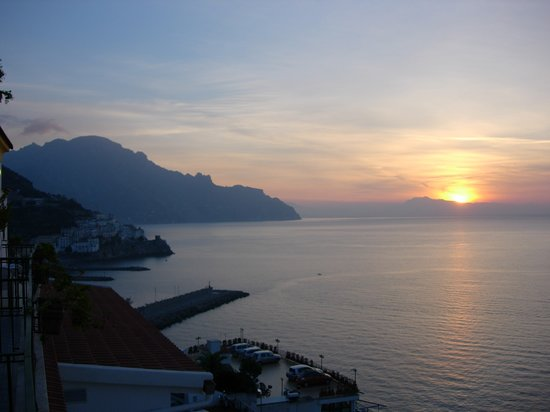 Sunrise from our terrace hotel room, overlooking Amalfi harbor.