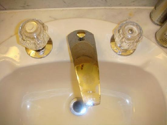 Clayton, MO: Bathroom sink - controls reversed and