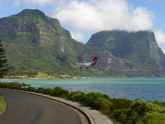 Capella Lodge: Plane landing over the lagoon with Capella on the hill in the background