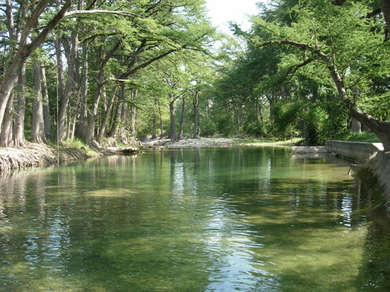 Bandera, TX: Medina River, which circles the ranch