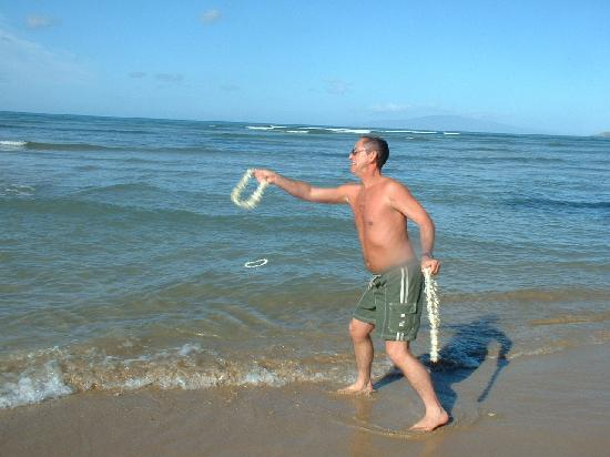 Hale Kai O'kihei: tossing our Lai's into the ocen in front of the Condo