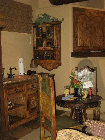 Adobe Grand Villas : Toward Kitchenette area with handwritten note on table for us...