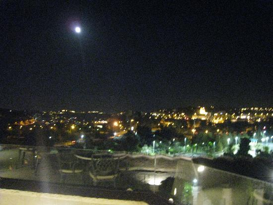 Inbal Jerusalem Hotel: full moon over the city from the lounge deck
