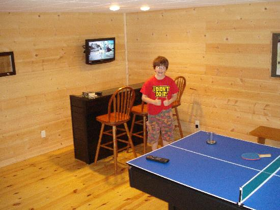 Wilderness View Cabins: Our son playing Play Station