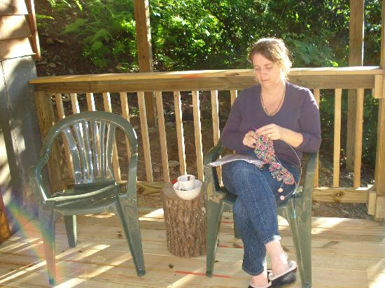 Wilderness View Cabins: My wife knitting on basement deck