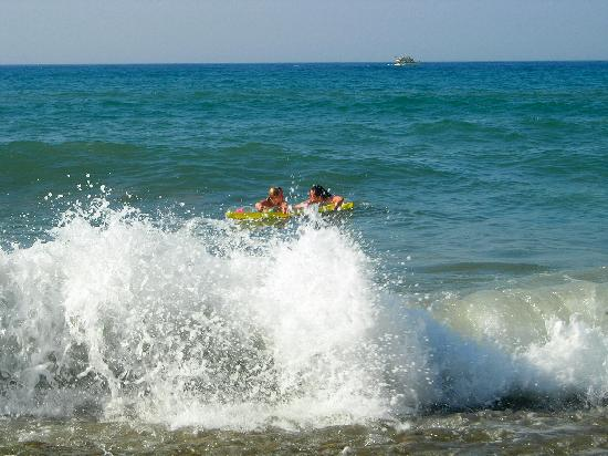 Bathing in the waves, beach Agia Marina